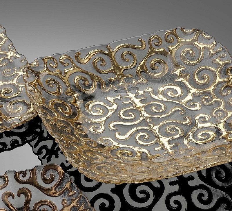 Collezione Shirdak in vetro trasparente con decoro oro